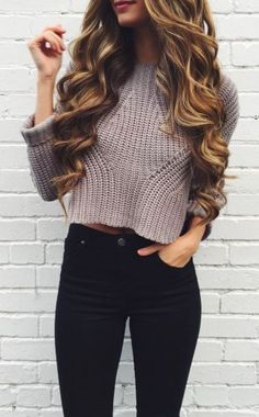 winter outfit- grey knit crop top, black jeans and curled brown hair