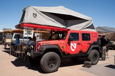 Jeep Wrangler with awesome rooftop tent – Now this is camping.  :)