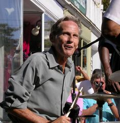 Levon Helm performing in 2004 on the Village Green in Woodstock, New York.