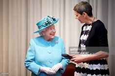 Queen Elizabeth II presents the Royal Medal to Professor Tessa Holyoake during a visit to the Royal Society of Edinburgh. (Photo by Jane Barlow/PA Images via Getty Images)