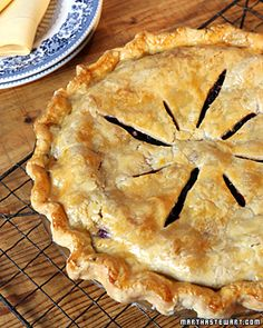 """Perfect Blueberry Pie  Cornstarch provides just the right amount of thickening in the fresh blueberry filling of this classic summer pie, adapted from """"Martha Stewart's Baking Handbook."""" Before baking, brush the crust with a mixture of egg yolk and cream to give it a golden, glossy finish."""