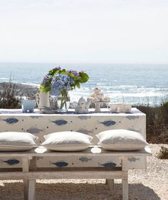 Arrange your spread on an ocean-vista picnic table and play up the nautical theme (fish motif on linens, blue hydrangeas) with the tabletop decor. Why do benches work so well outside? No backs, which will help keep the captivating view unobstructed for everyone.