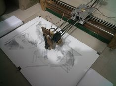 It is an Arduino, Customised GRBL, CoreXY, Servo and Stepper based CNC Drawbot that is Open Source and Open Hardware. It can draw or write using anything on anything.