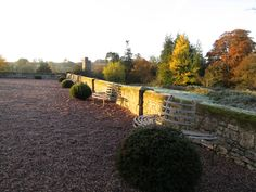 Huntsham Court with an Autumn Frost looking from the Western Terrace towards the village church.