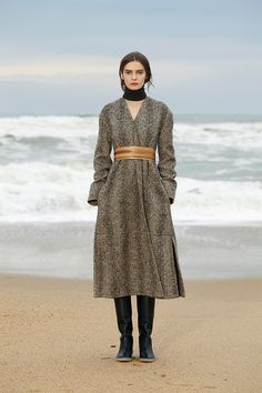 Christophe Lemaire tweed coat with wooden belt.