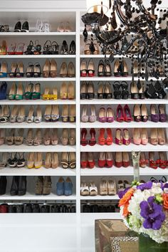 modern closet by Lisa Adams, LA Closet Design.  From Houzz.com.  Love, love, love the shoes organized by color!