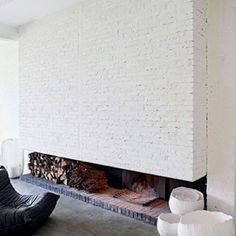 fireside as feature, exposed brick, beams... ❤️