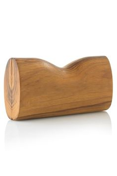 SHAPED WOODEN CLUTCH It looks 100% wonderful and French Connection's website says it's 100% wood.