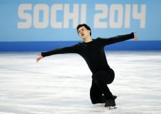 Chan of Canada skates during a figure skating training session in preparation for the 2014 Sochi Winter Olympics