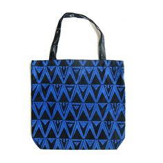 Screen printed tote bag by Bespoke Atelier.  Featuring snap closure and inside compartment with zip.