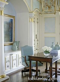 pale blue paneling with gold leaf accents...