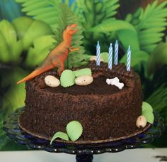 Jurassic World Party Ideas and Supplies - Dinosaur cake idea. Love this cake styled for Birthday Express and their Jurassic World party.