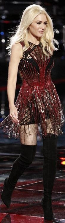 Gwen Stefani in Julien Macdonald red fringe dress and Casadei black thigh suede boots.