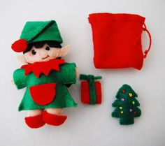 girl Pocket elf fits in altoid tin. She measures about 3 1/2 inches and comes with two accessories. Shoes and hat are removable. also comes with a little sack! Pattern will be available on my etsy! :)