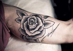 inner arm rose tattoo. love the stippled style..