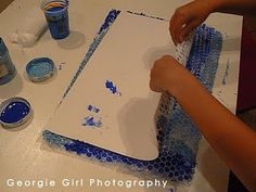 paint bubblewrap and lay down paper to make cool bubble print/ocean background. then add drawn/cutout fish =]