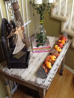 Chippy front door foyer table, dressed up with a chicken feeder full of fall decor.