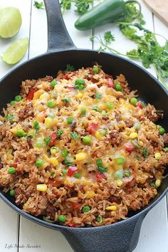 30 Minutes - Easy Mexican rice dish made entirely in one pan / one pot. Perfect & easiest for weeknights with the best taco flavors. Even the rice is made in the same pan.