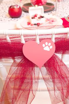 Love these decorated chairs at a Puppy Dog Valentine's Day Party!  See more party ideas at CatchMyParty.com!  #partyideas #valentine