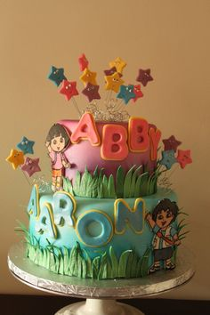 Dora and Diego Cake @Amber Ford do you like this one?? Only Dora an diego figures instead of fondant characters?