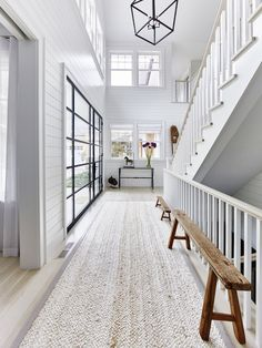 Check out this coastal dream home with organic texture, shiplap walls, and industrial steel-frame windows and doors. Its clean, fresh, and so pretty.
