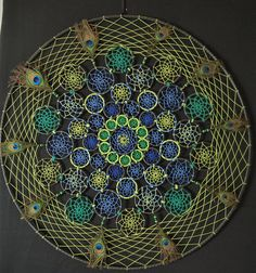 Mandala dream catcher, amazing gift for anyone who likes cool and unique things. and its perfect for wall decoration in any ambient. One of the largest dream catcher in the world, made with black leather, peacock theme colors, wood beads and peacock feathers Usual crafting time for