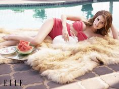 Anna Kendrick in the July 2014 issue of Elle Magazine, reclining on her side in a vintage-style bikini.