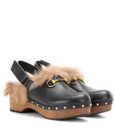 Gucci - Amstel fur-lined leather clogs - Crafted from smooth calfskin with a plush lamb fur lining, the Amstel clogs from Gucci will make a statement-making part of your fall-ready wardrobe. The label's iconic horsebit embellishment sits proudly at the front, while a sling-back heel strap adds comfort and ease to the platform pair. Style yours with a pleated skirt to embody the label's vintage-inspired look. seen @ www.mytheresa.com