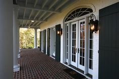 Traditional Exterior Brick Design, Pictures, Remodel, Decor and Ideas red brick porch.black shutters and lamps Colonial Exterior, Traditional Exterior, Exterior Design, Brick Design, Door Design, Painted Brick Exteriors, Brick Porch, Front Porch Design, Patio Design