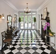 So often the floors are something that fade into the background, asking to be covered by a rug. Not so with this vibrant black and white pattern. This classic color combination can be re-created in marble, tile or linoleum for any style room and any budget.