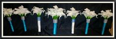 White Real touch calla lily set wrapped in Malibu Blue with rhinestone wrap. Maid of Honor Bouquets wrapped in white with turquoise rhinestone wrap. Need a quote klking@silkflowersbyjean.com