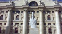 "Installation of Cattelan in ""Piazza Affari"", Milan (in front of the Italian stock exchange)."
