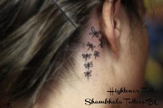 dragonfly tattoo behind ear