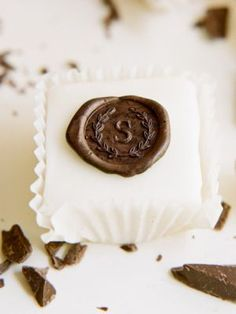 Fabulous for a wedding or other event, I may consider buying pre-made Petit Fours, and using a clean wax stamp (available at stationery stores), press initials into melted chocolate, right on top. So easy. And clever.