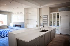 Too modern for me, but love the open kitchen into the family room.