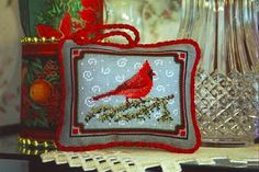 cardinal cross stitch ornament with free pattern