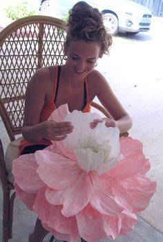 Michelle is in the process of painting one of the huge flowers