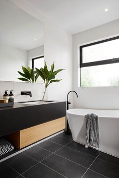R U S H ➕ V I V I D S L I M L I N E We absolutely love the black, white and timber styling in this stunning ensuite in The Langham 44 house from ! This bathroom features our Rush Wall Set and Vivid Slimline Floor Mounted Bath Mixer, b Minimalism Interior, House, Home, Modern Bathroom, White Bathroom, Bathrooms Remodel, Bathroom Design, Beautiful Bathrooms, Black Bathroom