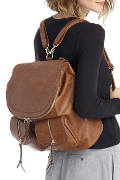 ca078127ce54 Brown backpack with front pockets and braided zipper pulls Brown Backpacks