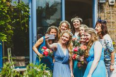 Blue bridesmaids dresses. Coral and pink peonies. Wedding flowers and gypsophila head dresses by Flowers by Kirsty. www.flowersbykirsty.com