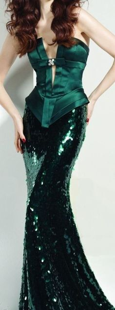 Look elegant at the office Christmas party in this emerald green sequin gown with satin bodice.