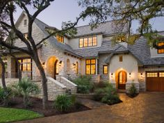 Love the stone and the cottage Tudor design
