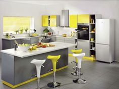 Grey and Yellow Kitchen with Zanussi appliances     The name should ring a bell, as the original Quadro range was launched in 1999 and gained an army of devotees.