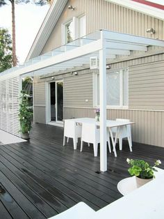 NOTE: Cantilevered glass canopy and dark stained decking
