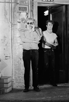 freecocaine: Andy Warhol and his assistant, Gerard Malanga, at the Factory, 1964.