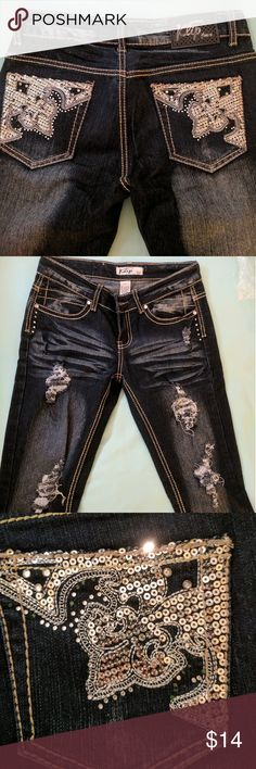 ✨👖 Stylish distressed sequin jeans These are a dark wash with sequined pockets, and SUPER distressed front. More gems next to the front pockets and large gem front button. A few gems on rear pockets are gone, but it's hardly noticable with all of those sequins! Klip Jeans Skinny