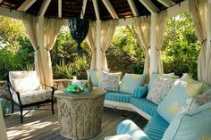 gazebo with curtains and upholstered furniture