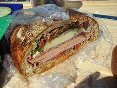 Muffaletta sandwich that I would make with either portobollo mushrooms or vegetarian deli slices.