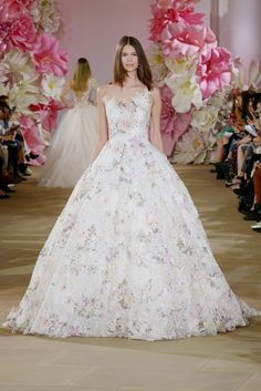 Ines Di Santo 'Bloom' gown  Sleeveless illusion asymmetrical floral print natural waist ball gown with illusion back.