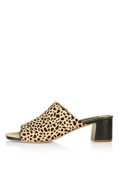 Mules: The secret to wearing heels without the pain.Topshop Nino Leopard Print Mules, $100, available at Topshop. #refinery29 http://www.refinery29.com/business-casual-for-women#slide-26